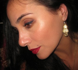 Laura Mercier Spellbound Illuminator w/Highlight 01 on the cheek bones.