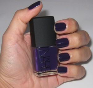 Nars Fury nail polish against a white background--looks more indigo than purple.
