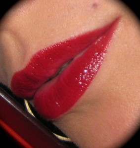 Estee Lauder Pure Color High Intensity Lip lacquer in Ruby Glow lip swatch.