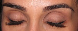 Add mascara and line the bottom lash line with Bottomless Java.