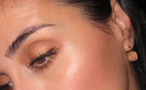 RMS Beauty Living Luminizer on the cheeks and inner corner of the eye.