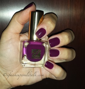 Estee Lauder Insolent Plum Pure Color Nail Lacquer with flash.