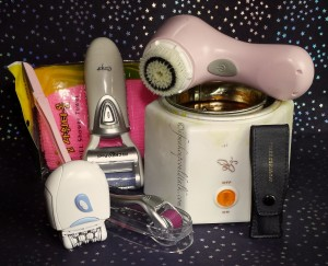 Personal Care Essentials: Emjoi Micro-Pedi, Emjoi Epilator, Clarosonic Mia, Cleaning cloth, Dermaroller, Gigi Space Saver Wax, Warmer with Honee, Tweezerman Tweezers.